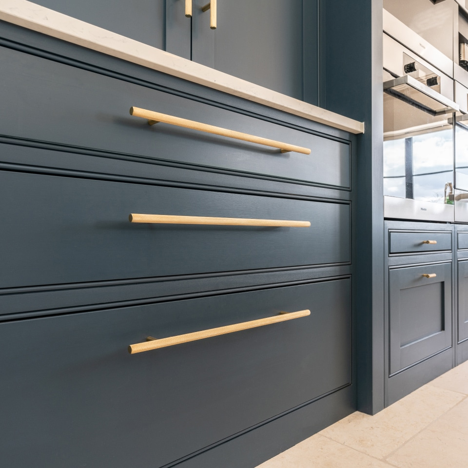 armac martin brass bar handles on blue handmade kitchen