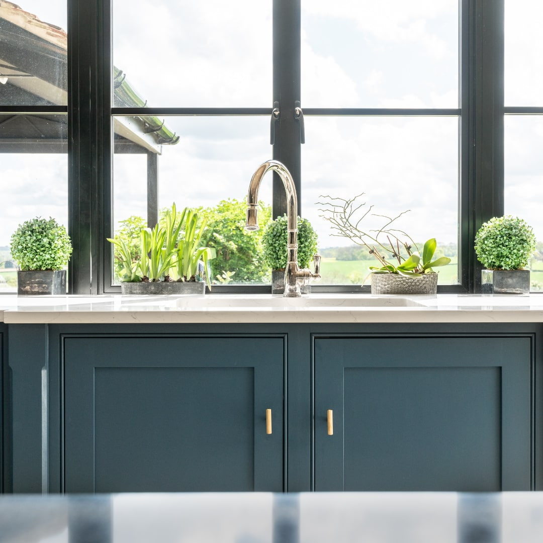 classic shaker kitchen with healthy plants incorporated into design