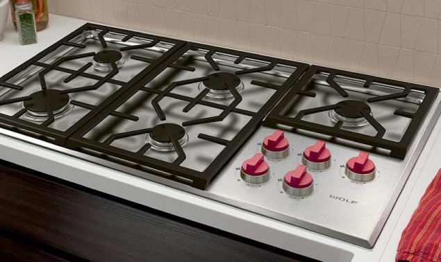 Stainless Steel Wolf Gas Cooktop with red knobs