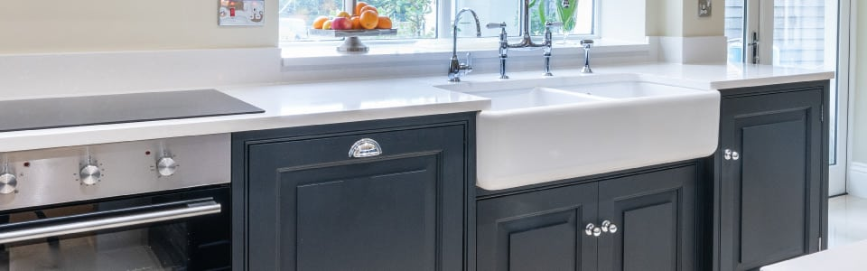 traditional blue shaker kitchen with belfast sink